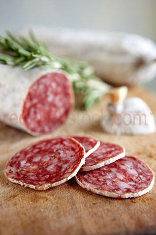 meat;meats;pork;pork sausage;pork sausages;cured pork sausage;cured pork sausages;sliced;herb;herbs;rosemary;chopping board;chopping boards;cured meat;cured meats;cured pork;salami;salamis;red meat;red meats;preserved meat;preserved meats;preserve;preserved