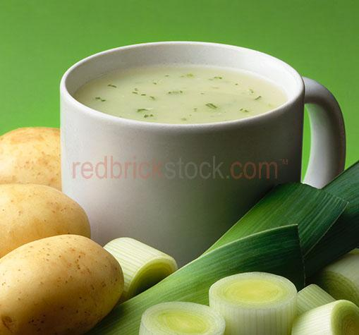 leek and potato soup;leek and potato soups;potato and leek soup;potato and leek soups;potatoes;potato;uncooked;leeks;leek;ingredient;ingredients;soup in a mug;soup in a cup;cup of soup;mug of soup;lunch;lunches;dinner;dinners;plated food;plate;plates;prepared dish;prepared dishes;portions;portion;prepared;serving;servings;starter;starters;snack;snacks;entree;entrees