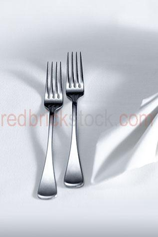 cutlery;silver service;fork;forks;dining fork;dining forks;napkin;napkins;folded napkin;folded napkins;table;tables;table setting;table settings;setting;settings;dinner;dinner setting;dinner settings;dinner table setting;dinner table settings;dine;dines;dining;meal;meals;menu;menus;restaurant;restaurants;cafe;cafes;cafe dining;cloth;cloths;table cloth;table cloths;white table cloth;white table cloths;white;whites;linen;white linen;banquet;banquets;wedding;wedding table setting;wedding table settings;reception;receptions;wedding reception;wedding receptions;wedding reception table setting;wedding reception table settings;supper;suppers;lunch;lunches;kitchenware;dining setting;dining settings;close-up;close-ups;close up;close ups;closeup;closeups;close-up view;close-up views;closeup view;closeup views;close-up views;close-up view's;close up views;closeup views;copyspace;copy space;textspace;text space;empty;shiny;two;2;two forks;2 forks