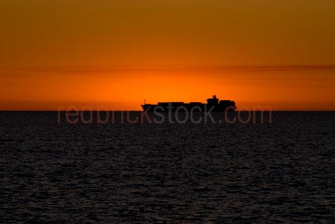 bulk carrier;carriers;cargo ship;container ship;merchant ship;shipping;ship;ships;vessel;vessels;freight;export;import;exports;imports;one ship;silhouette;silhouetted;silhouettes;in silhouette;sunset;sun set;sun rise;sunrise;west australia;australia;australian;coast;coasts;coastal;coastline;coastlines;coast line;coast lines;seascape;seascapes;shore;shoreline;shores;shorelines;shore line;shore lines;seaside;sea side;beach;beaches;sunset;sun set;sunsets;sun sets;golden sunset;orange sky;gold tones;warm tone;warm tones;cottesloe beach;perth;dusk;twilight;evening;late afternoon;last light;copyspace;copy space;textspace;text space