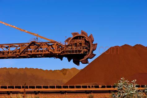 bhp;fmg;heavy industry;iron ore;mining;mine;newman;pilbara;port hedland;reclaimer;western australia;wa;australia;loading area;minerals;resources;stacker;stockpile;industry;industrial;heavy industry;mining machinery;mining equipment;day;daytime;blue sky;blue skies;outback;desert;close-up;close up;close-ups