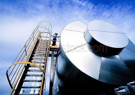 tank; tanks; liquid tank; liquid tanks; storage tank; storage tanks; liquid storage tank; liquid storage tanks; gas tank; gas tanks; gas storage tank; gas storage tanks; gas; gases; liquid gas; liquid gases; petroleum gas; petroleum gases; liquified petroleum gas; liquified petroleum gases; lpg; gpl; lp gas; petroleum tank; petroleum tanks; petroleum storage tank; petroleum storage tanks; petroleum; petroleum gas tank; petroleum gas tanks; petroleum gas storage tank; petroleum gas storage tanks; liquified petroleum gas tank; liquified petroleum gas tanks; liquified petroleum gas storage tank; liquified petroleum gas storage tanks; petrol tank; petrol tanks; petrol storage tank; petrol storage tanks; petrol; petrols; fuel tank; fuel tanks; fuel storage tank; fuel storage tanks; fuel; fuels; industrial tank; industrial tanks; industrial storage tank; industrial storage tanks; container; containers; storage container; storage containers; storage; storages; storing; industrial; industry; industries; gas industry; gas industries; energy industry; energy industries; energy; energies; industrial site; industrial sites; work site; work sites; on industrial site; on industrial sites; on work site; on work sites; at industrial site; at industrial sites; at work site; at work sites; uniform; uniforms; safety gear; safety clothing; personal protective equipment; ppe; safety equipment; protective equipment; protective gear; protective clothing; protection; safety protection; safety hat; safety hats; hard hat; hard hats; hat; hats; ladder; ladders; industrial ladder; industrial ladders; steps; industrial steps; industrial gas; industrial gases; propane; butane; flammable; flammable gas; flammable gases; natural gas; natural gases; power; industrial plant; industrial plants; refinery; refineries; industrial refinery; industrial refineries; gas refinery; gas refineries; petroleum refinery; petroleum refineries; oil refinery; oil refineries; environment; environmental; environmental damage; environmental issue; environmental issues; environmental impact; environmental impacts; environmental effects; environmental effects; climate change; global warming; factory; factories; industrial factory; industrial factories; occupation; occupations; job; jobs; vocation; vocations; employment; australian occupation; australian occupations; australian job; australian jobs; australian employment; employee; employees; australian employee; australian employees; career; careers; australian career; australian careers; workman; workmen; tradesperson; people; person; australian person; australian people; australian; australians; aussie; aussies; man; men; guy; guys; male; males; australian man; australian men; australian guy; australian guys; australian male; australian males; work; works; working; worker; workers; at work; workplace; workplaces; at the workplace; in the workplace; uniform; uniforms; safety gear; safety clothing; personal protective equipment; ppe; safety equipment; protective equipment; protective gear; protective clothing; protection; safety protection; safety hat; safety hats; hard hat; hard hats; hat; hats; working outside; working outdoors;  one; 1; one person; 1 person; australia; australian; aus; blue; blues; colour blue; color blue; sky; skies; blue sky; blue skies; clear sky; clear skies; clear blue sky; clear blue skies; against blue sky; day; daytime; day time; during the day; in the daytime; in the day time; daylight; day light; white cloud; white clouds; fluffy cloud; fluffy clouds; white fluffy cloud; white fluffy clouds; fluffy white cloud; fluffy white clouds; overcast; overcast sky; overcast skies; overcast weather; cumulonimbus cloud; cumulonimbus clouds; cloudy sky; cloudy skies; cloudy; low view; low views; low angle; low angles; from below; looking up; looking up at; copyspace; copy space; textspace; text space; close-up; close-ups; close up; close ups; closeup; closeups; close-up view; close-up views; closeup view; closeup views; close-up views; close-up views; close up views; closeup views; and; &; +;