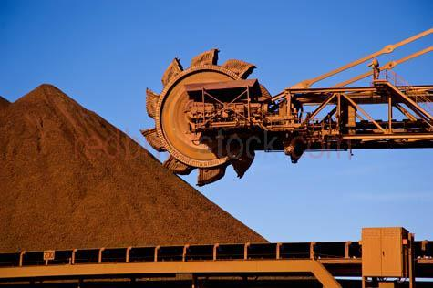 bhp;fmg;heavy industry;iron ore;mining;mine;newman;pilbara;port hedland;reclaimer;western australia;wa;australia;loading area;minerals;resources;stacker;stockpile;industry;industrial;heavy industry;mining machinery;mining equipment;day;daytime;blue sky;blue skies;outback;desert