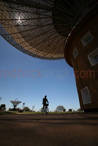 dish;the dish;dishes;observatory;observatories;parabolic;antenna;antennas;parkes;nsw;new south wales;australia;aus;oz;radiothermal telescope;radiothermal telescopes;radio thermal;radio;radio telescope;radio telescopes;telescope;astronomy;astronomer;movable dish;movable dishes;stars;star;moon;moons;moon landing;nasa;apollo 11;broadcast;broad cast;galaxy;galaxies;universe;bike;bikes;bicycle;bicycles;worker;workers;person;people;one person;one man;one guy;single figure;riding bike;riding bikes;riding bicycle;riding bicycles;silhouette;silhouettes;silhouetted;hard hat;hard hats;helmut;helmuts;blue sky;blue skies;clear sky;clear skies;sun;sunny;sunshine;copy space;copy spaces;text space;text spaces