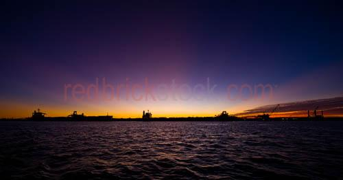 wa;western australia;port hedland;ship;ships;shipping;industry;industrial;port;ports;sunset;dawn;dusk;skyline;seascape;colrful;colourful;crane;cranes;dredge;dredging;freight;harbour;loading;marine;ocean;pier;silhouette;silhouetted;silhouettes;water;pano;panorama;panoramic;textspace;text space;copyspace;copy space;CUG2010