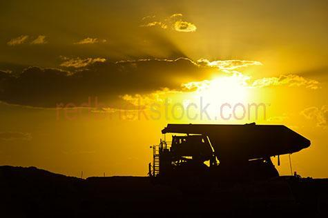 coal;coal mine;coal mines;coal mining;mine;mines;mining;open cut;open cut mine;open cut mining;open cut mines;mining coal;coal seam;quarry;quarries;quarryÕs;mining vehicle;mining vehicles;mining truck;mining trucks;mine truck;mine trucks;resource;resources;raw materials;industry;industrial;heavy industry;environment;environmental;environmental damage;scarred land;day;daytime;day time;gravel;machinery;mining machinery;heavy machinery;coal mining truck;coal mining trucks;coal mining machinery;drive;drives;driving;yellow;yellows;colour yellow;color yellow;clermont;queensland;qld;australia;australian;aus;clermont mine;clermont mines;clermont mining;sun;sunny;sun ray;sun rays;sunray;sunrays;sunbeam;sunbeams;sun beam;sun beams;ray;rays;ray of light;sunset;sunsets;sun set;sun sets;sun setting;silhouette;silhouetted;silhouettes;silhouetted coal mining truck;silhouetted mining truck;silhouetted truck;silhouetted machinery;silhouetted coal mining machinery;silhouetted mining machinery;cloud;clouds;dramatic sky;dramatic skies