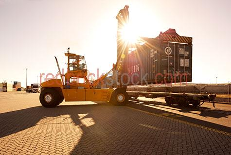 forklift;forklifts;industrial forklift;industrial forklifts;freight terminal;freight terminals;rail terminal;rail terminals;freight rail terminal;freight rail terminals;terminal;terminals;train;trains;freight train;freight trains;container;containers;shipping container;shipping containers;industrial container;industrial containers;industrial site;industrial sites;work site;work sites;industry;industries;industrial;mining industry;mining industries;mining;coal mining;coal terminal;coal terminals;logistics;lift;lifts;lifting;load;loads;loading;rail;rails;railway;railways;rail way;rail ways;carriage;carriages;train carriage;train carriages;sun;bright sun;sunburst;sun burst;sunray;sunrays;sun ray;sun rays;ray of light;rays of light;sunbeam;sunbeams;sun beam;sun beams;sun flare;sun flares;sun flaring;occupation;occupations;job;jobs;vocation;vocations;employment;australian occupation;australian occupations;australian job;australian jobs;australian employment;employee;employees;australian employee;australian employees;career;careers;australian career;australian careers;workman;workmen;tradesperson;tradespeople;trades person;trades people;tradey;tradie;tradeys;tradies;people;person;australian person;australian people;australian;australians;aussie;aussies;man;men;guy;guys;male;males;australian man;australian men;australian guy;australian guys;australian male;australian males;work;works;working;worker;workers;at work;workplace;workplaces;at the workplace;in the workplace;shift work;work shift;work shifts;high visual;high vis;hi vis;high visual clothing;high vis clothing;hi vis clothing;high visual clothes;high vis clothes;hi vis clothes;working outside;working outdoors;day;daytime;day time;during the day;daylight;day light;port;ports;port of brisbane;brisbane;queensland;qld;australia;australian;aus;copyspace;copy space;textspace;text space;warm tone;warm tones;and