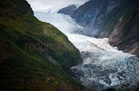 franz josef;glacier;glaciers;glacial;new zealand;landscape;landscapes;Ka Roimata o Hinehukatere;westland national park;national park;national parks;south island;travel;travels;traveling;travelling;tourist destination;tourist destinations;holiday;holidays;vacation;vacations;ice;icy;icey;frozen;glacial lake;glacial lakes;waiho river;rivers;winter;snow;snowy;snows;mountain;mountains;mountainous