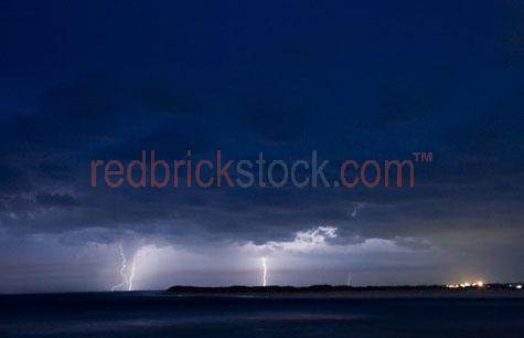 storm lightning coast sea beach electricity weather severe cloud
