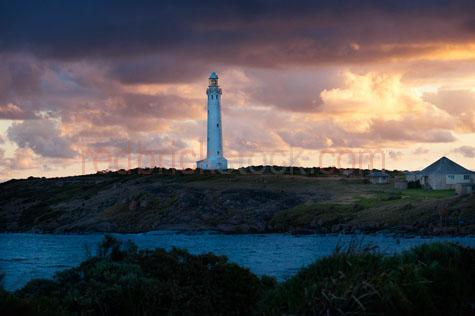 lighthouse;lighthouses;stormy;stormy sky;stormy skies;cloud;cloudy;cloudy sky;cloudy skies;cliff;rocky cliff;cliffs;clifftop;seaside;sea;ocean;shore;shores;shoreline;shorelines;coastline;coastlines;rocky;rocks;augusta;cape leeuwin;cape leeuwin lighthouse;western australia;sunset;sunsets;dusk;dusks;rugged;isolated;isolation;desolate;lighthouse keeper;lighthouse keeper's cottage;cottage;solitary