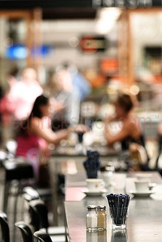 cafe;cafes;table;tables;coffee;outdoor cafe;outdoor cafes;lunch;meeting for lunch;meeting for coffee;social;socialise;socialize;socializing;women;two women;woman;lady;two ladies;ladies;blur;blurred;out of focus;outdoor dining;dine;dining