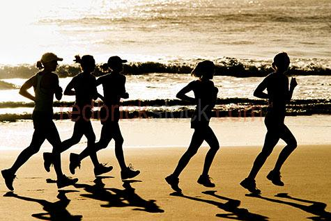 jogging;woman jogging;health;beach;fitness;sunrise;morning;exercise;exercising;womens health;womens fitness;fit women;fit woman;woman running;women running;women jogging;woman jogging;silhouetted women running;silhouetted woman running;running on beach;running along beach;girls running;girl running;lady running;ladies running;coastal lifestyle;beaches;sunrise;dawn;early morning;jogging group;running group;group of people running;group of women running;group of people jogging;group of women jogging