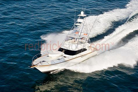 recreational boating;boat;boats;fishing;pleasure craft;marine;ocean;boat heading out to the ocean;water;sea;motoring;cruising;cruiser;fast launch;sunny day;apartment living;coastal lifestyle;leisure;recreation;summer;fishing boat