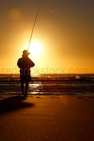 beach;beaches;coast;coasts;coastal;coastline;coastlines;coast line;coast lines;coastal living;coastal lifestyle;shore;shoreline;shores;seaside;sea side;fisherman;fishermen;one man;one person;one guy;one fisherman;silhouetted fisherman;silhouette fisherman;silhouette fishermen;silhouette man;silhouette guy;silhouette person;man on beach;men on beaches;fisherman on beach;fishermen on beach;fishermen on beaches;leisure;lifestyle;coastal lifestyle;coastal living;beach lifestyle;beach living;tourism;sunset;sunsets;sun set;sun sets;sunrise;sunrises;sun rise;sun rises;warm tone;warm tones;gold tone;gold tones;orange;colour orange;color orange;holiday;holidays;vacation;vacations;water;ocean;oceans;sea;seas;fishing;fish;man fishing;men fishing;person fishing;people fishing;man fishing beach;men fishing beach;person fishing beach;people fishing beach