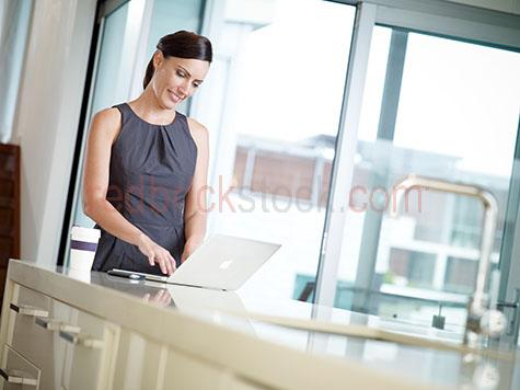 lifestyle;home;homes;at home;lady at home;woman at home;person at home;people at home;woman;women;lady;ladies;female;females;laptop;laptops;apple laptop;apple laptops;mac laptop;mac laptops;working;working from home;checking emails;email;emails;emailing;woman on her laptop;lady on her laptop;using laptop;using laptops;woman using a laptop;woman using a laptop at home;lady using laptop;lady using laptop at home;morning;morning time;kitchen;kitchens;domestic kitchen;domestic kitchens;kitchen bench;kitchen benches;30-35 years;30 to 35 years;30-35 yrs;30 to 35 yrs;mid 30s;mid 30's;mid thirties;35-40 years;35 to 40 years;35-40 yrs;35 to 40 yrs;mature adult;35-40 years;35 to 40 years;35-40 yrs;35 to 40 yrs;mature adult;mid 30s;mid 30's;mid thirties;getting ready for work;business woman