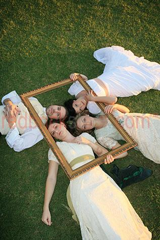 four 4 people frame dresses dress angelic white on grass young f