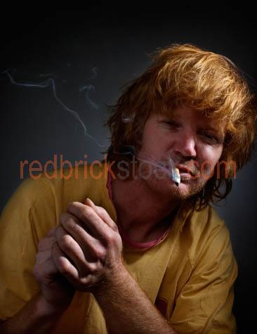 man;smoking;cigarette;cigarettes;homeless;destitute;dishevelled;