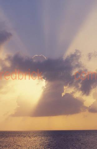 sun;setting;set;clouds;water;rays;beams;
