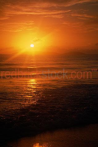 sun;rise;sunrise;rising;over;beach;ocean;sea;sand;coast;coastline;early morning;crashing waves;wave;orange