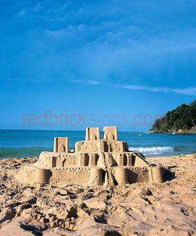 sandcastle;sand castle;beach;summer;beaches;making a sandcastle;making a sand castle;fun on the beach;fun on beaches;vacation;holiday;build;building a sand castle;building a sandcastle;ocean;sea;sand sculpture