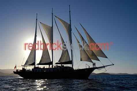 sail;sails;sailing;boat;boats;ship;ships;boating;ocean;oceans;sea;seas;wooden ship;wooden ships;sailboat;sailboats;marine;maritime;vessel;vessels;frigate;frigates;whitsunday;whitsundays;tall ship;tall ships;three masted schooner;three masted schooners;3 masted schooner;3 masted schooners;cruise;cruises;cruising;great barrier reef;reef;reefs;australia;australian;north queensland;north qld;nth qld;blue sky;blue skies;silhouetted;silhouettes;silhouette