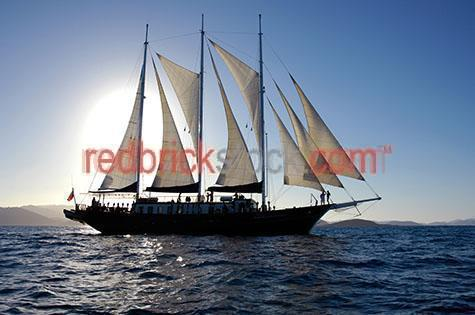 sail;sails;sailing;boat;boats;ship;ships;boating;ocean;oceans;sea;seas;wooden ship;wooden ships;sailboat;sailboats;marine;maritime;vessel;vessels;frigate;frigates;whitsunday;whitsundays;tall ship;tall ships;three masted schooner;three masted schooners;3 masted schooner;3 masted schooners;cruise;cruises;cruising;great barrier reef;reef;reefs;australia;australian;north queensland;north qld;nth qld;blue sky;blue skies;silhouette;silhouettes;silhouetted