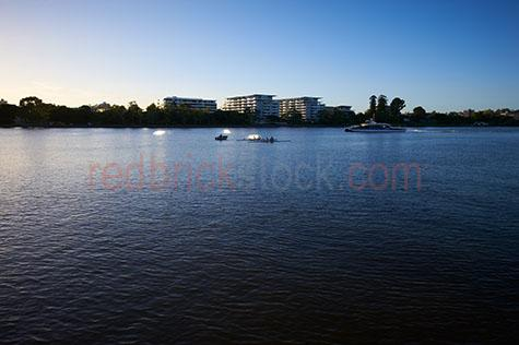west end;westend;brisbane;apartment;apartments;apartment building;apartment buildings;building;buildings;city building;city buildings;rowers;rowing;team sport;team sports;paddling;sport;sports;training;rowing training;row;rows;fitness;staying fit;endurance;endurance sport;endurance sports;kyak;kyaks;kyaking;brisbane river;river;rivers;water;river water;silhouette;silhouettes;silhouetted;in silhouette;silhouetted rowers;silhouetted rowing team;silhouetted rowing teams;people;person;action;paddle;paddles;exercise;exercising reflection;reflections;water reflection;water reflections;water surface;early morning;morning;queensland;qld;australia;australian;aus;blue;blues;colour blue;color blue;blue water;sunlight;sun light;copyspace;copy space;textspace;text space;glistening water;glistening;glisten;glistens;sparkling;sparkling water;sparkle;sparkles;boat;boats;small boat;small boats;fishing boat;fishing boats;motor boat;motor boats;blue sky;blue skies;clear blue sky;clear blue skies;citycat;citycats;city cat;city cats;brisbane city;brisbane citycats;brisbane city cat;brisbane city cats;ferry;ferries;pubic transport;brisbane public transport;transport;transports;transporting;transportation;commuter;commuters