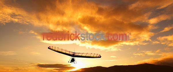 sunset;sunsets;sunrise;sunrises;orange;oranges;colour orange;color orange;recreation;recreational;sport;sports;silhouette;silhouettes;silhouetted;hangliding;hanglider;hangliders;hanggliders;hang glide;hang gliding;glider;gliders;hang gliders;hang glider;fly;flying;flies;soar;soars;soaring;extreme sport;extreme sports;adventure sport;adventure sports;man;guy;one man;one guy;one person;outdoor;outdoors;adventure;adventures;adventure sport;adventure sports