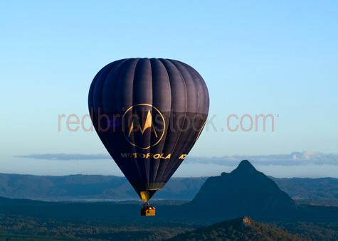 hot air balloon;hot air balloons;hot air ballooning;ballooning;glass house mountains;mt beerwah;malaney range;range;ranges;valley;field;fields;rural;valley;valleys;vallies;countryside;countrysides;country sides;country side;farmland;farmlands;qld;queensland;australia;australian;recreation;recreations;recreational;leisure;tourism;tourist destination;tourist destinations;holiday destination;holiday destinations;vacation;vacations;fly;flies;flying;flight;float;floating;floats;mountain;mountains;mountainous