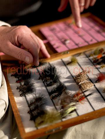 fly fishing;fish;sport;recreation;lure;tackle;hands;hand;angling;trout;lake taupa;new zealand;nz;flies;rod;lures;feathers;feather;fresh water;artificial;freshwater;man;male