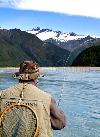 fly fishing;fish;sport;recreation;lure;tackle;hands;hand;angling;trout;lake taupa;new zealand;nz;flies;rod;lures;feathers;feather;fresh water;artificial;freshwater;man;male;mountain;mountains;net;nets;cast;casting