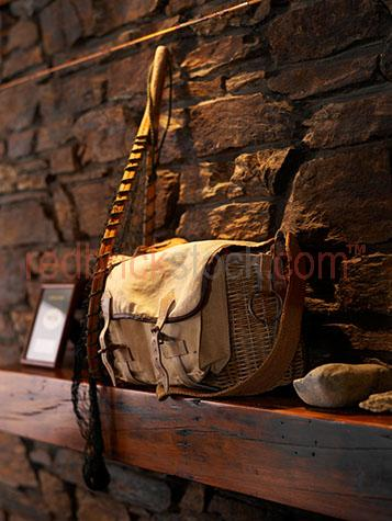 fish;fishing;fly fishing;basket;bag;net;nets;netting;equipment;mantle;brick;bricks;wall;brick wall