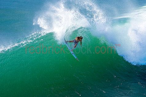 surf;surfer;wave;waves;tube;green;ocean;surfing;surfboard;surf board;ride;riding;surfers;hawaii;curl;tube;guy;man
