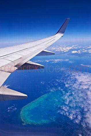 the great barrier reef;great barrier reef;reef;reefs;queensland;north queensland;qld;north qld;australia;australian;aus;ocean;water;sea;sea water;view;views;aerial view;aerial views;aerial;aerials;aerial view of the great barrier reef;great barrier reef aerial;flying over the great barrier reef;airline;airlines;airliner;airliners;airplane;airplanes;aircraft;aircrafts;aeroplane;aeroplanes;plane;planes;jet;jets;passenger jet;passenger jets;aviation;flight;flights;fly;flying;flying over clouds;flying through clouds;above clouds;view through airplane window;view out airplane window;plane;aeroplane;wing;wings;plane wing;aeroplane wing;airline wing;airliner wings;wingtip;wing tip;fly;flying;above;clouds;cloud;flight;travelling;journey;daytime;day time;traveling;travels;travel;planes;aeroplanes;airliners;holiday;holidays;holiday destination;holiday destinations;destination;destinations;tourist destination;tourist destinations;travel;traveling;vacation;vacations;flying high above clouds;cumulus clouds;cumulus cloud;looking out window;looking out airplane window;looking out aeroplane window;looking out plane window;looking out airliner window;window;jet plane wing;jet plane wings;air;mid air;mid-air;blue;blues;colour blue;color blue;tropical;tropic;tropics;tropical holiday;tropical holidays;tropical vacation;tropical vacations