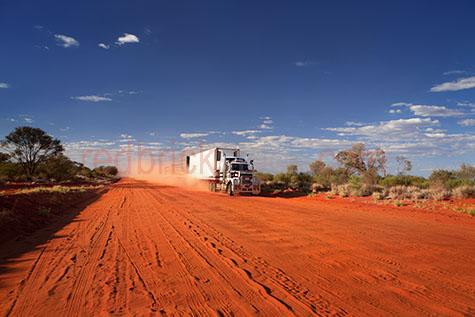 road train;road trains;roadtrains;roadtrain;truck;trucks;australia;australian;aus;semi trailor;semi trailors;semi trailer;semi trailers;semi;semis;transportation;transport;transports;transporting;prime mover;prime movers;transportation truck;transportation trucks;semi trailor truck;semi trailor trucks;semi trailer truck;semi trailer trucks;roads;road;dirt road;dirt roads;dirt track;dirt tracks;track;tracks;outback;out back;australian outback;australian out back;outback australia;out back australia;country road;country roads;country setting;country settings;country;countryside;country side;rural;rural road;rural roads;rural setting;rural settings;lorry;lorrie;lorries;lorrys;blue sky;blue skies;cloud;clouds;drive;drives;driving;industrial truck;industrial trucks;truck driver;truck drivers;driver;drivers;vehicle;vehicles;heavy vehicle;heavy vehicles;red earth;red dirt;dirt;dirts;red soil;dust;dusty;kicking up dust;copyspace;copy space;textspace;text space