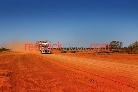 road train;roadtrain;truck;trucks;truck on dirt road;transportation;transport;semi trailor;prime mover;desert;unsealed road;dust;primemover;outback