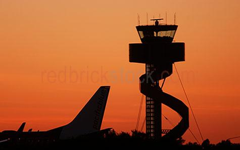 airport;airports;plane;planes;airplane;airplanes;aeroplane;aeroplanes;tail;tails;flight control;air;air traffic;air traffic control;tower;towers;control tower;control towers;building;buildings;structure;structures;sunrise;sunrises;sun rise;sun rises;sunsets;sunset;sun set;sun sets;orange;oranges;colour orange;color orange;silhouette;silhouettes;silhouetted;sydney airport;australia;australian;new south wales;capital city;capital cities;copy space;copy spaces;text space;text spaces