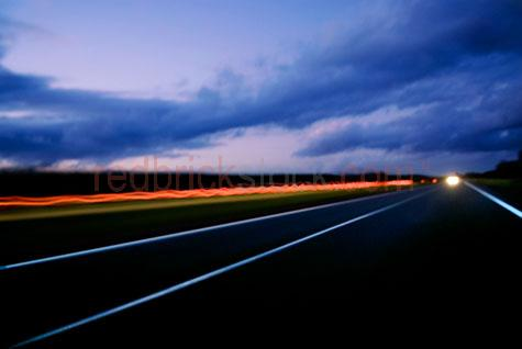 speeding;freight;transport;speed;highway;freeway;transporting;headlights;blur;blurred;streak;streaking;high speed;night driving;fast moving;transporting;transportation;headlights;head lights;twilight;dusk;highways;freeways;bruce highway;main road;main roads;background;back ground;backgrounds;back grounds;open road;open roads;driving down highway at night;driving down freeway at night