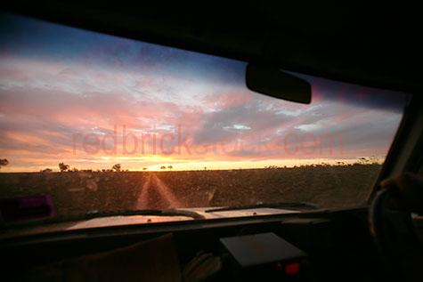 ute;utes;car;cars;automobile;automobiles;auto;interior;inside;utility vehicle;vehicle;vehicles;driving;drive;drives;track;tracks;road;roads;dust;dusty;dirt;dirty;dirt road;dirt roads;dirt track;dirt tracks;bush;bushland;bush land;bushlands;bush lands;sunset;sunsets;sun set;sun sets;sunrise;sunrises;sun rise;sun rises;ligh rays;light ray;cloud;clouds;dramatic sky;dramatic skies;cumulus cloud;cumulus clouds;outback;out back;rural;australia;australian;aus;oz;farm;farms;dirty window;dirty windows;looking out window;looking out windows;silhouette;silhouetted;silhouettes;travel;travels;travelling;traveling;travelled;traveled;holiday;holidays;vacation;vacations