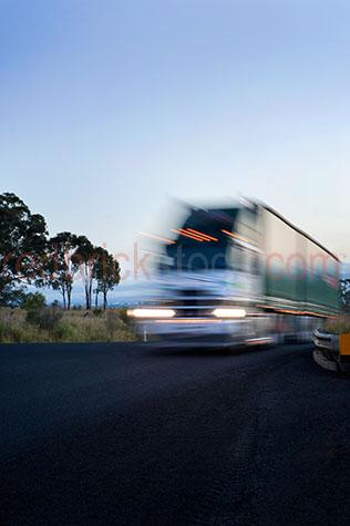 road train;road trains;roadtrains;roadtrain;truck;trucks;new south wales;nsw;australia;australian;aus;semi trailor;semi trailors;semi trailer;semi trailers;semi;semis;transportation;transport;transports;transporting;prime mover;prime movers;transportation truck;transportation trucks;semi trailor truck;semi trailor trucks;semi trailer truck;semi trailer trucks;roads;road;gravel road;gravel roads;country road;country roads;country setting;country settings;country;countryside;country side;hill;hills;mist;misty;misty morning;morning;early morning;morning time;lorry;lorrie;lorries;lorrys;blue sky;blue skies;clear blue sky;clear blue skies;drive;drives;driving;industrial truck;industrial trucks;copyspace;copy space;textspace;text space;speed;speeds;speeding;fast;fast paced;streak;streaking;blur;blurring;blurred;blury;blurry;movement;low angle;low view;low viewpoint;motion blur;headlights;head lights;truck headlights;truck head lights;tree;trees;driving through the country;driving through country setting;vehicle;vehicles