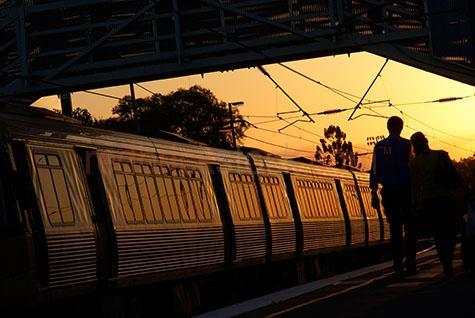 train at station;track;tracks;trains;queensland;qld;rail;electric;travel;traveling;platform;transport;transportation;sunset;sun set;people;commuting;commuters;commuter;passenger;passengers;travellers;boarding train;metropolitan;metro;city;cities;train station;train stations;gold tone;gold tones;warm tone;warm tones;orange;color orange;colour orange;silhouette;silhouettes;silhouetted;passengers leaving train;passengers leaving trains;disembarking;railway;railways;railway station;railway stations