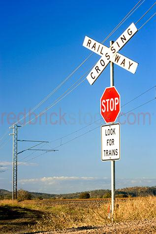 railway crossing;railway crossings;rail way crossing;rail way crossings;train line;train lines;trainline;trainlines;railway;railways;rail way;rail ways;railway track;railway tracks;rail way track;rail way tracks;train track;train tracks;track;tracks;train crossing;train crossings;train;trains;railway crossing sign;railway crossing signs;rail way crossing sign;rail way crossing signs;stop sign;stop signs;look for trains sign;look for trains signs;look for trains;stop;sign;signs;signage;road sign;road signs;road signage;train sign;train signs;train signage;australia;australian;aus;copyspace;copy space;textspace;text space;daytime;day time;daylight;day light;blue sky;blue skies;country;country setting;country settings;rural;rural area;rural setting;rural settings;powerline;powerlines;power line;power lines;electricity pylon;electricity pylons
