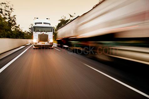 truck;trucks;trucking;truck speeding;freight;transport;rig;semi;semi-trailer;speed;highway;highways;motorway;motorways;freeways;freeway;transports;transporting;logistics;blur;blurred;streak;streaking;high speed;truck driver;truck drivers;wreckless;fast moving;panning;lorry;lorries;lorrie;lorrys;transporting;transportation;street;streets;ocertake;over take;overtaking;over taking;freight;freights;two trucks;2 trucks