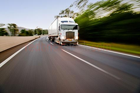 truck;trucks;trucking;truck speeding;freight;transport;rig;semi;semi-trailer;speed;highway;highways;motorway;motorways;freeways;freeway;transports;transporting;logistics;blur;blurred;streak;streaking;high speed;truck driver;truck drivers;wreckless;fast moving;panning;lorry;lorries;lorrie;lorrys;transporting;transportation;street;streets;ocertake;over take;overtaking;over taking;freight;freights;warrego;blue sky;blue skies