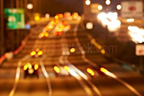 highway;highways;high way;motorway;motorways;motor way;freeway;freeways;expressway;expressways;m1;m 1;pacific motorway;traffic;night;night traffic;freeway traffic;highway traffic;lanes;lights streaking;car tailights;car tail lights;car lights;lights;headlights;lane marking;lane markings;blur;blurred;blurring;out of focus;abstract;movement;multi lane highway;turnpike;road;roads;speed;speeding;night driving;night lights;median strip;drive;driving;multi lane;multi lanes;multi-lanes;multi-lane;driving fast;street lighting;speeding down highway;speeding down motorway;speeding down freeway;excessive speed;aerial;aerial view;aerial view of cars;car;vehicles;motoring;motor vehicles;driving at night;transport;transportation;multi lane;commuting;arterial;white lines;vehicle emissions;pollution;cars;blur;blurred vision;blurred vision;abstract;colour orange;color orange;warm tone;warm tones;gold tone;gold tones;sign;signs;signage;traffic sign;traffic signs
