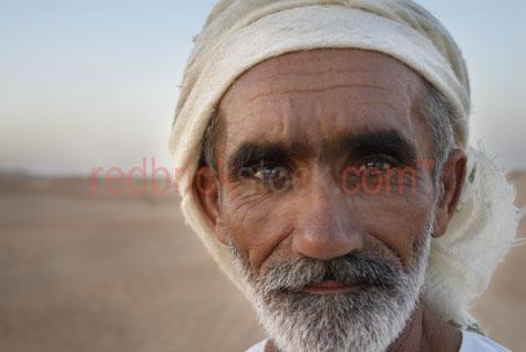 Camel herder desert dubai travel exotic eyes sand man old