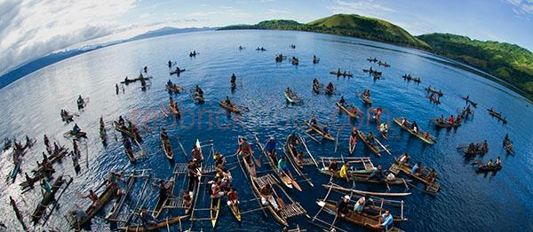 aurora expeditions;goodenough island;island;islands;png;papua new guinea;tropics;tropical;men;man;canoe;canoes;men in canoes;man in canoe;wide angle;fish eye;boats;men in boats;man in boat;boat;raft;rafts;men in rafts;man in raft;men in raft;papua new guineans;locals;native;natives;oar;oars;paddle;paddles;water;lake;lakes;sea;seas;ocean;oceans
