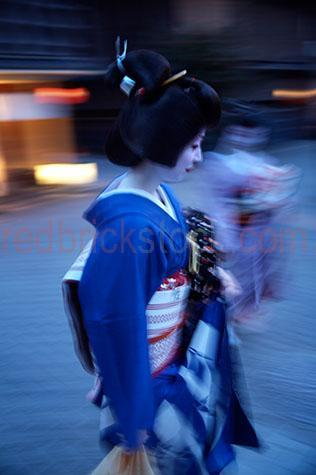 geisha;geishas;geisha girl;geisha girls;maiko;maikos;maiko girl;maiko girls;kyoto;japan;japanese;honshu;honshu island;island of honshu;geiko;geiokos;performing artist;performing artists;performer;performers;artist;artists;japanese girl;japanese girls;japanese woman;japanese women;japanese lady;japanese ladies;woman;women;girl;girls;lady;ladies;dancer;dancers;traditional;furisode;okobo;geisha clothing;make up;heavy make up;face paint;white face;painted white face;kimono;kimonos;shimada hairstyle;shimada hairstyles;tradition;traditions;japanese tradition;japanese traditions;chignon;blue;blues;colour blue;color blue;walk;walks;walking;move;moves;movement;motion;motion blur