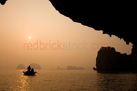 halong bay;vietnam;bay;bays;asia;asian;water;waters;sea;seas;ocean;oceans;vietnamese;tourist destination;holiday destination;holiday destinations;tourist destinations;vacation;vacations;rock;rocks;travel;travels;travelling;traveling;travelled;traveled;boat;boats;rowboat;rowboats;row boat;row boats;peaceful;scenic;on boat;on boats;mountain;mountains;mountainous;silhouette;silhouettes;silhouetted;fog;fogs;foggy;mist;misty