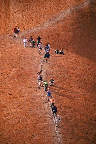 tourist;tourists;sight seeing;sightsee;sight see;travel;travelling;uluru;ayres rock;ayers rock;landmark;northern territory;outback;tour;people;crowd;desert;central australia;rock;rocks;backpackers;travellers;sacred sight;aboriginal territory;climb;climbing;handrail;rail